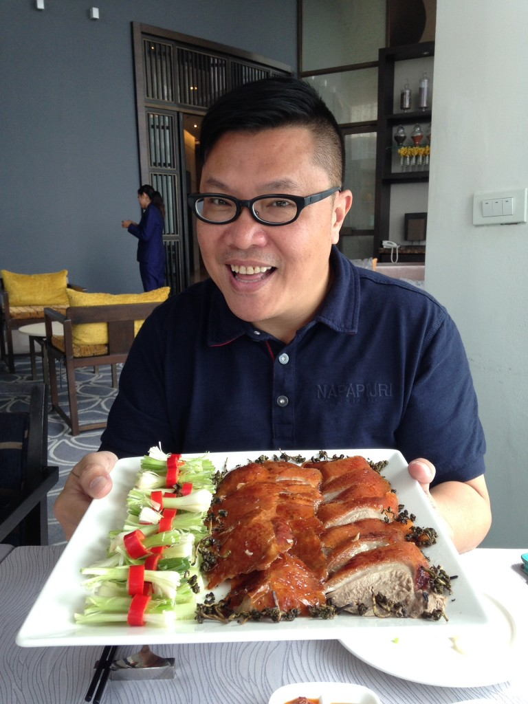 Roger Wu, a famous food critic, enjoyed Silver Waves Tea Infused Peking Duck